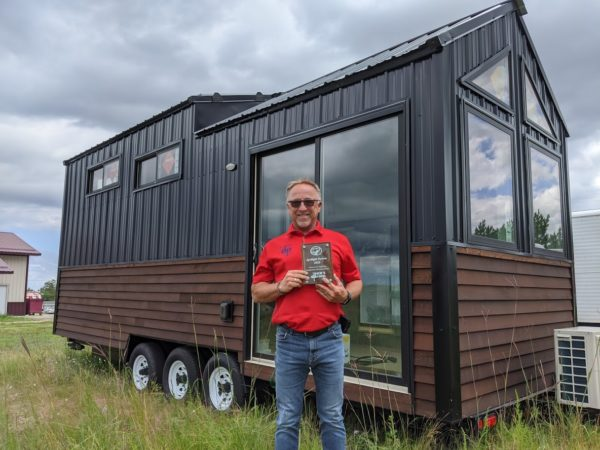 Gregg in front of BSU's Tiny House